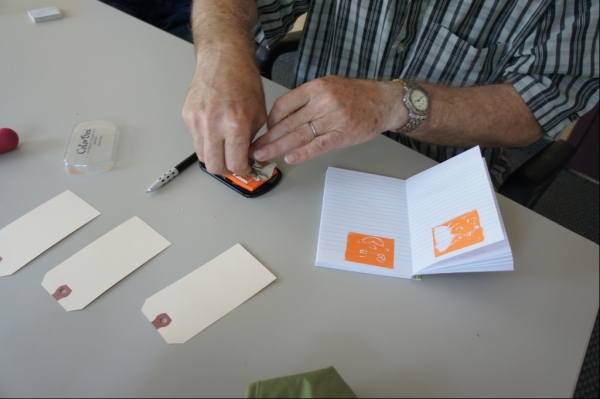Don using a Stamp Pad
