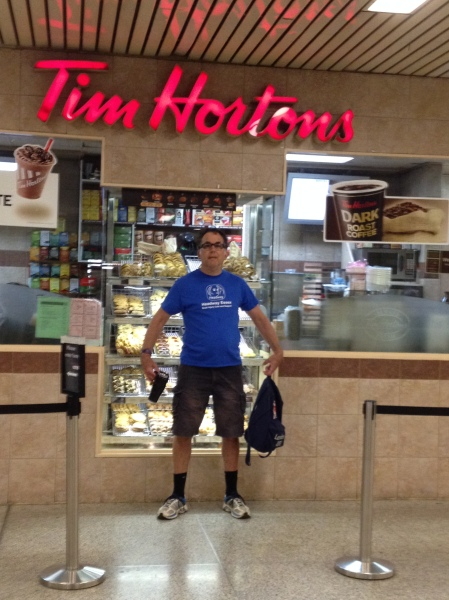Rob in front of Tim Hortons - a Canadian favourite for coffee lovers