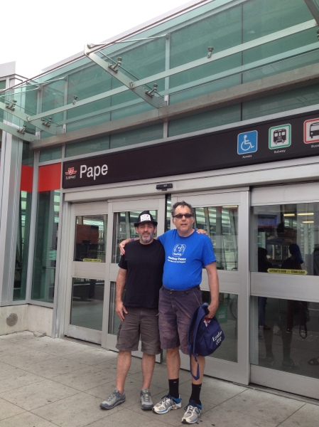 Rob and David Slonim, Mentor's Coordinator in front of Pape Subway Station