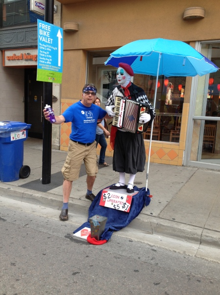 Rob with a street performer on Yonge Street in Toronto